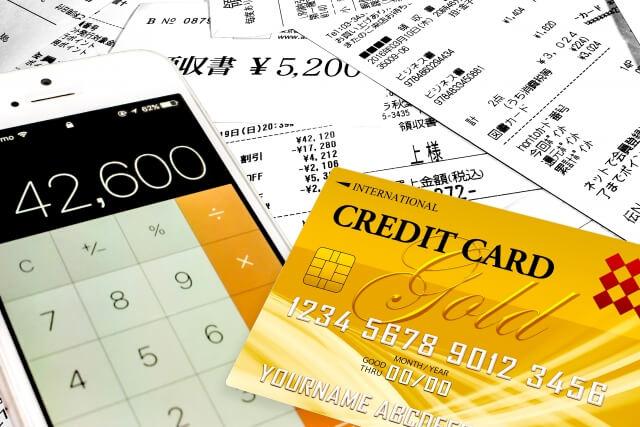 販売・飲食・金融イメージ|クレジットカード・電卓・明細